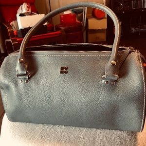 Kate Spade barrel shaped handbag.